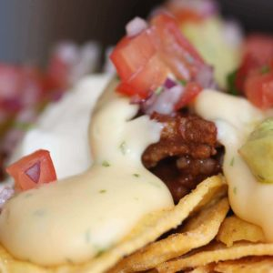 close up of nachos and queso