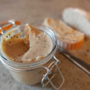 nut butter with knife and bread